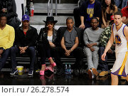 Купить «Celebrities at the Los Angeles Clippers game. The Golden State Warriors defeated the Los Angeles Clippers by the final score of 115-112 at Staples Center...», фото № 26278574, снято 20 февраля 2016 г. (c) age Fotostock / Фотобанк Лори