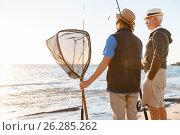 Купить «Senior man fishing with his grandson», фото № 26285262, снято 15 апреля 2015 г. (c) Sergey Nivens / Фотобанк Лори