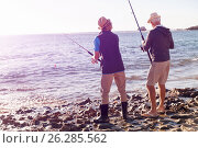 Купить «Senior man fishing with his grandson», фото № 26285562, снято 15 апреля 2015 г. (c) Sergey Nivens / Фотобанк Лори