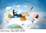 Купить «Aviator in retro plane. Mixed media», фото № 26307470, снято 23 июля 2018 г. (c) Sergey Nivens / Фотобанк Лори