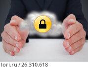 Купить «Business man at desk with cloud and yellow lock graphic between hands against grey background», фото № 26310618, снято 25 февраля 2020 г. (c) Wavebreak Media / Фотобанк Лори
