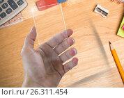 Купить «Hand with glass screen on table with objects», фото № 26311454, снято 22 июля 2019 г. (c) Wavebreak Media / Фотобанк Лори