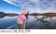 Double exposure of woman performing yoga at lakeshore. Стоковое фото, агентство Wavebreak Media / Фотобанк Лори