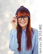 Купить «Portrait of happy redheaded female hipster wearing eyeglasses and knit hat», фото № 26312482, снято 25 сентября 2018 г. (c) Wavebreak Media / Фотобанк Лори