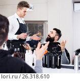 Купить «client feeling discontent about his new haircut at hair salon», фото № 26318610, снято 27 января 2017 г. (c) Яков Филимонов / Фотобанк Лори