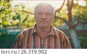 Купить «Middle aged man at sunset», видеоролик № 26319902, снято 15 мая 2017 г. (c) Илья Шаматура / Фотобанк Лори