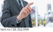 Купить «Midsection of businessman touching screen», фото № 26322094, снято 19 февраля 2019 г. (c) Wavebreak Media / Фотобанк Лори