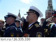Купить «Военные моряки во время исполнения государственного гимна на Красной площади во время генеральной репетиции парада, посвященного 72-годовщине Победы в Великой Отечественной войне», фото № 26335330, снято 7 мая 2017 г. (c) Free Wind / Фотобанк Лори
