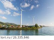 Купить «turbines at wind farm on sea shore», фото № 26335846, снято 8 февраля 2017 г. (c) Syda Productions / Фотобанк Лори