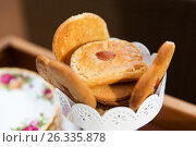 Купить «close up of almond cookies in vase», фото № 26335878, снято 21 февраля 2017 г. (c) Syda Productions / Фотобанк Лори