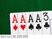 Купить «poker hand of playing cards on green casino cloth», фото № 26335950, снято 15 марта 2017 г. (c) Syda Productions / Фотобанк Лори