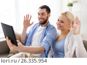 Купить «couple with tablet pc having video chat at home», фото № 26335954, снято 11 февраля 2017 г. (c) Syda Productions / Фотобанк Лори