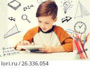 Купить «close up of boy with tablet pc computer at home», фото № 26336054, снято 24 октября 2015 г. (c) Syda Productions / Фотобанк Лори