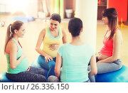 Купить «happy pregnant women sitting on balls in gym», фото № 26336150, снято 5 марта 2016 г. (c) Syda Productions / Фотобанк Лори