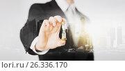 Купить «close up of businessman hand holding hourglass», фото № 26336170, снято 21 марта 2013 г. (c) Syda Productions / Фотобанк Лори