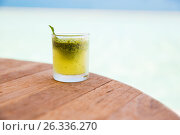 Купить «glass with drink or cocktail on bar table», фото № 26336270, снято 15 февраля 2015 г. (c) Syda Productions / Фотобанк Лори