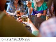 Купить «friends drinking beer at bar or pub», фото № 26336286, снято 14 июля 2016 г. (c) Syda Productions / Фотобанк Лори
