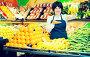 Portrait of adult female selling fruits and vegetables, фото № 26340850, снято 10 марта 2017 г. (c) Яков Филимонов / Фотобанк Лори