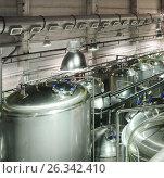 Metal tanks for storage and processing of food liquids. Стоковое фото, фотограф Андрей Радченко / Фотобанк Лори