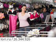 Купить «Glad woman shopping lace uplifts and panties», фото № 26344926, снято 23 октября 2018 г. (c) Яков Филимонов / Фотобанк Лори