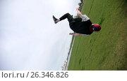 Купить «Back flip somersault in slow motion. Teenager male performing acrobatic jump in park, camera turns together with the athlete», видеоролик № 26346826, снято 20 апреля 2018 г. (c) Константин Шишкин / Фотобанк Лори