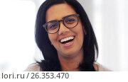 Купить «happy smiling indian young woman in glasses», видеоролик № 26353470, снято 22 марта 2017 г. (c) Syda Productions / Фотобанк Лори