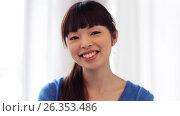 Купить «happy smiling asian young woman», видеоролик № 26353486, снято 22 марта 2017 г. (c) Syda Productions / Фотобанк Лори