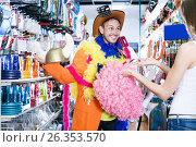 Купить «Male with girlfriend trying on cowboy hat and smiling», фото № 26353570, снято 11 апреля 2017 г. (c) Яков Филимонов / Фотобанк Лори