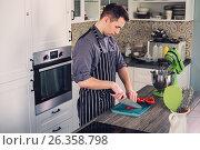 Купить «Chef cook working on a modern kitchen at home», фото № 26358798, снято 6 июля 2020 г. (c) Andrejs Pidjass / Фотобанк Лори