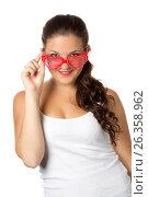 Young girl is holding red sunglasses, фото № 26358962, снято 6 июля 2011 г. (c) Tatjana Romanova / Фотобанк Лори