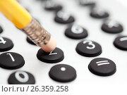 Купить «Простой деревянный карандаш с ластиком на калькуляторе», фото № 26359258, снято 15 сентября 2011 г. (c) Александр Гаценко / Фотобанк Лори