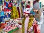 Female customers staring at counter of Christmas market, фото № 26359646, снято 25 мая 2017 г. (c) Яков Филимонов / Фотобанк Лори