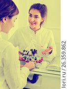 Купить «Female manicurist showing lacquer color schemes», фото № 26359862, снято 2 февраля 2017 г. (c) Яков Филимонов / Фотобанк Лори