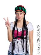 Girl in a hat shows a peace sign, фото № 26360670, снято 22 января 2012 г. (c) Tatjana Romanova / Фотобанк Лори