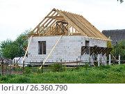 Construction of the Unfinished white foam block house. Стоковое фото, фотограф Никита Ковалёв / Фотобанк Лори