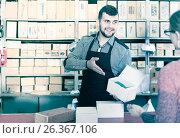 Купить «seller helping female client to choose door hinges in houseware shop», фото № 26367106, снято 5 апреля 2017 г. (c) Яков Филимонов / Фотобанк Лори