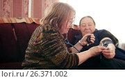 Купить «Women pensioners - checking health state with manometer - measures pressure, pensioners healthcare», видеоролик № 26371002, снято 21 июля 2018 г. (c) Константин Шишкин / Фотобанк Лори