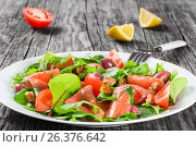 Купить «Red fish healty salad on white dish», фото № 26376642, снято 22 марта 2019 г. (c) Oksana Zh / Фотобанк Лори