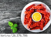 Купить «Grilled sausages on a white dish, top view», фото № 26376786, снято 22 августа 2018 г. (c) Oksana Zh / Фотобанк Лори