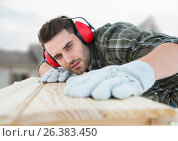 Купить «Carpenter on building site», фото № 26383450, снято 19 августа 2019 г. (c) Wavebreak Media / Фотобанк Лори