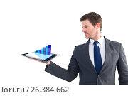 Businessman holding a tablet with digital graphics. Стоковое фото, агентство Wavebreak Media / Фотобанк Лори