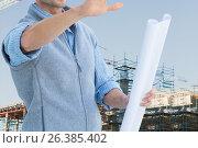 Купить «Worker with plans at construction site», фото № 26385402, снято 18 января 2019 г. (c) Wavebreak Media / Фотобанк Лори