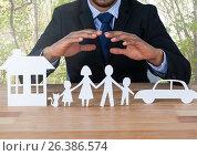 Купить «Cut outs House Family and Car with model and trees», фото № 26386574, снято 23 сентября 2018 г. (c) Wavebreak Media / Фотобанк Лори