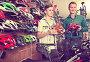 Smiling father and son choosing bicycling helmet, фото № 26389538, снято 27 сентября 2016 г. (c) Яков Филимонов / Фотобанк Лори