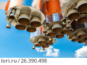Купить «Space rocket engines of the russian spacecraft over blue sky background», фото № 26390498, снято 25 мая 2017 г. (c) FotograFF / Фотобанк Лори