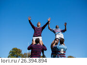 Low angle view of rugby players against clear sky. Стоковое фото, агентство Wavebreak Media / Фотобанк Лори