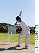 Купить «Determined cricketer playing on field», фото № 26395178, снято 9 февраля 2017 г. (c) Wavebreak Media / Фотобанк Лори