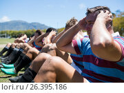 Close up of rugby players exercising. Стоковое фото, агентство Wavebreak Media / Фотобанк Лори