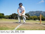 Player batting at field against clear sky. Стоковое фото, агентство Wavebreak Media / Фотобанк Лори
