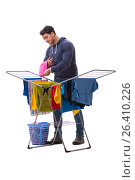Купить «Husband man doing laundry isolated on white», фото № 26410226, снято 6 марта 2017 г. (c) Elnur / Фотобанк Лори